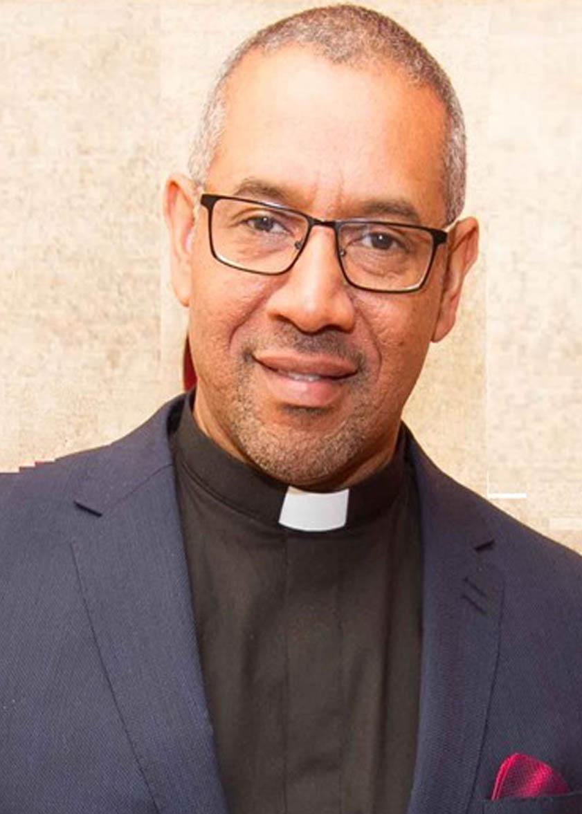Rev Desmond Reid